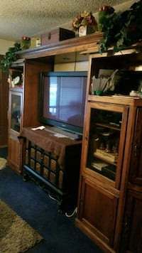 brown wooden TV hutch  Dallas, 75216