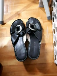 pair of black leather sandals Montreal, H8Y 2L1