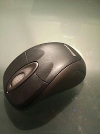 black and gray Microsoft bluetooth computer mouse