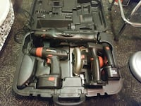 black and brown portable power drill and circular saw with case