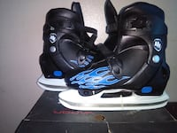 pair of black and blue ice skating shoes with box TORONTO