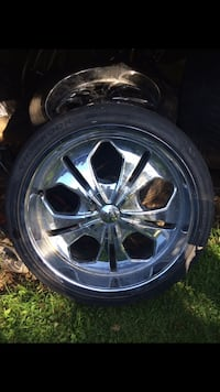 Two chrome 5-spoke car wheels and tires 821 km
