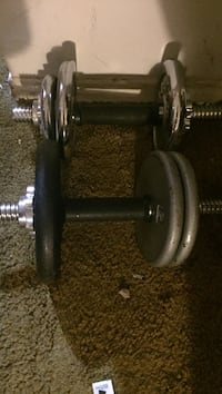 two unpaired gray and black dumbbells London, N5Z 3N2