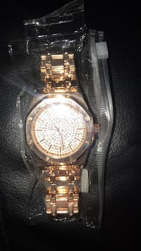 Round silver analog watch with gold link bracelet Newport News, 23608