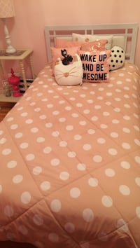 quilted pink and white polka dot bed set