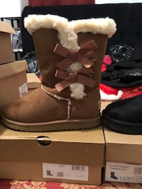 pair of brown-and-white sheepskin boots Manassas Park, 20111