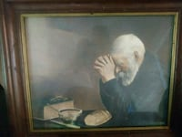 man in white dress painting with brown wooden frame Columbia, 29210