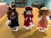 7 porcelain dolls with stands  147 mi