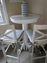 round white wooden table with two chairs 282 mi