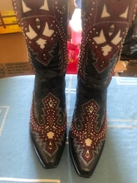 pair of brown leather cowboy boots Edinburg, 78542