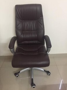 Brown leather rolling chair