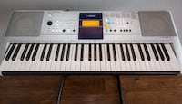 Yamaha electric keyboard with stand
