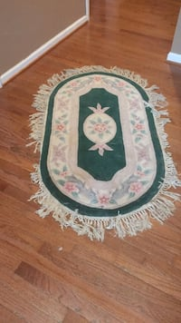 oval green and white floral floor mat 73 km