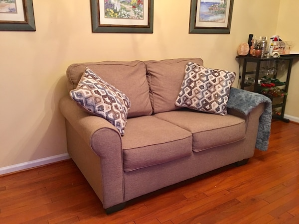Gray fabric 3-seat sofa with two pillows