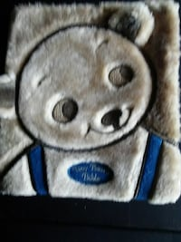 brown and blue bear printed area rug