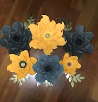 Paper flowers grey and yellowy orange colour.