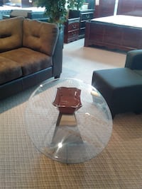 Oval new glass top coffee table only 299