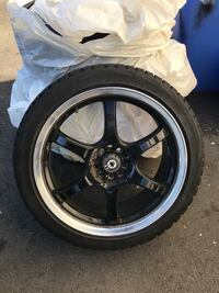 Blizzak snowtires with universal rims Langley, V1M 3T3