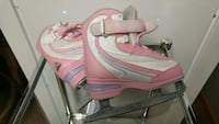pair of white-and-pink leather ice skates