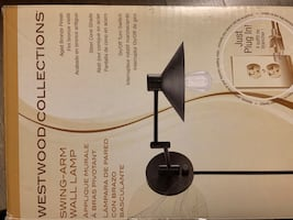 Wall mount lamp with swinging arm (3 available) plugs into wall (plug)