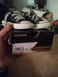 pair of black Converse All Star low-top sneakers with box