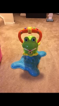toddler's green, blue, and orange frog ride-on toy Hagerstown, 21740