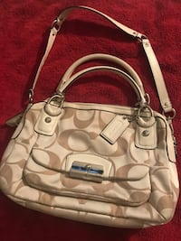 White and beige coach two way hand bag
