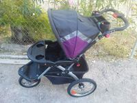 baby's black and red jogging stroller Las Vegas, 89122