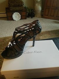 pair of black leather open-toe heels 236 mi