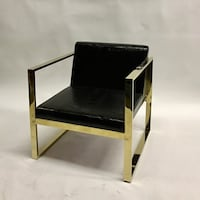 gold plated frame black leather armchair