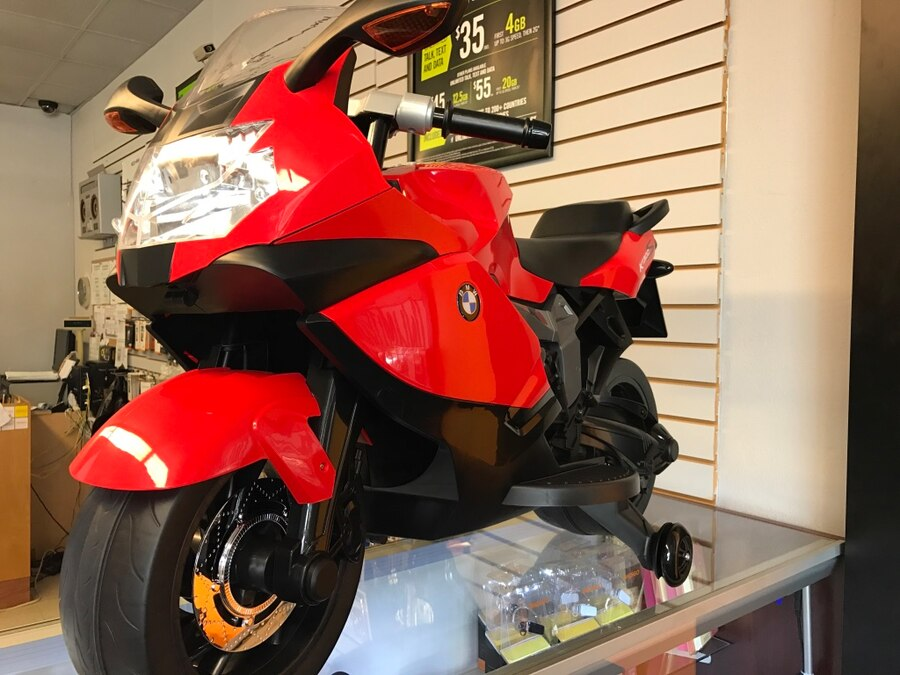 children's red and black ride on sports bike