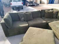 gray suede sectional sofa with throw pillows