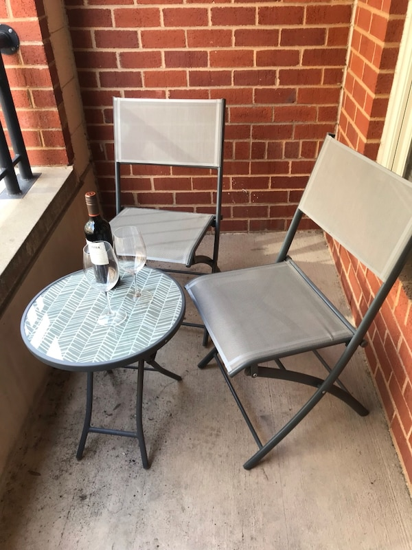 Patio table & two matching folding chairs (used once)
