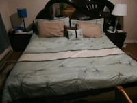 brown wooden bed frame and white mattress Montreal