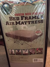 Ozark trail queen bed frame and blow up mattress in a bag Melbourne, 32940