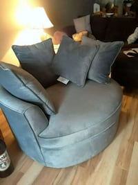 gray suede sofa chair with throw pillow Calgary, T2A 1B4