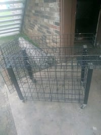 Cage with door and. Wheels and a basket. On to p f