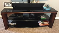 black glass top brown wooden base TV stand