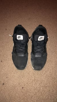 pair of black Nike low-top sneakers Pointe-Claire, H9R 3H8