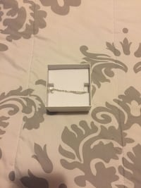 silver-colored bracelet with box