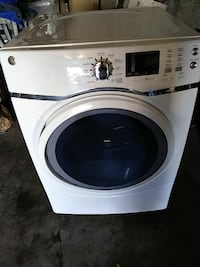 white General Electric front load clothes dryer