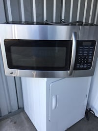 MICROWAVE BY:GE STAINLESS W/Mounting Hardware.Works Great! Hampstead