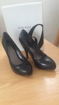 pair of black closed-toe high-heeled Nine West shoes. Leather. Size 7 1/2