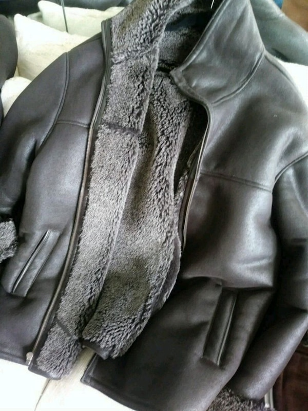 Two of the Same Brown leather Coats