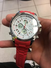 round silver chronograph watch with red strap Montréal, H4L 3V9