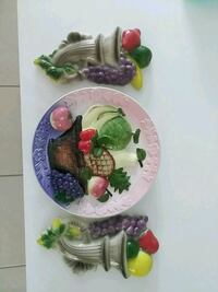 white, green, and purple floral ceramic plate