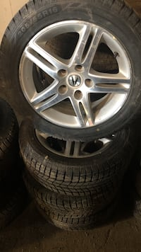 four gray Acura 5-spoke vehicle wheel with tire set