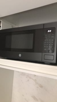 Brand new GE microwave; 800 watts; 12 in depth, 11 in ht, 24 in length. Came with my new condo but I have one already. Washington, 20009
