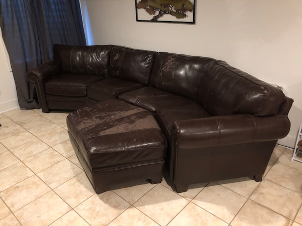 Dark brown leather couch and ottoman