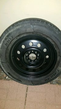 Extra tire and rim for car
